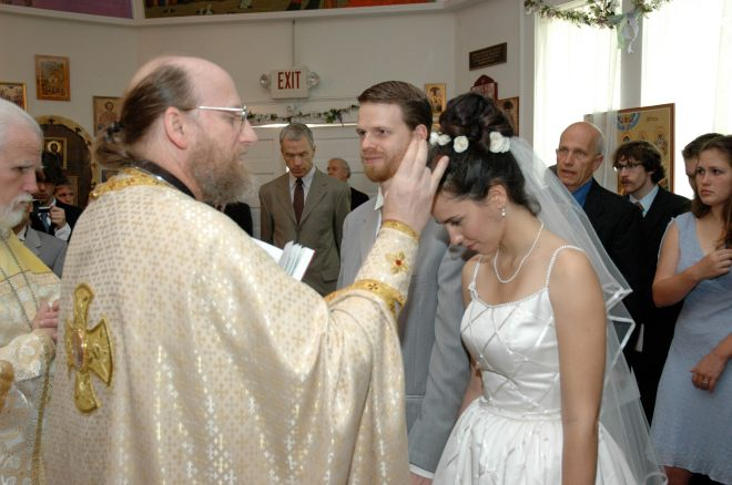 Fr. Jacob blessing us at our wedding.